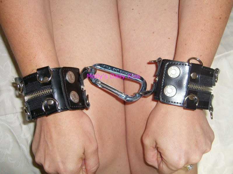 Molly wearing cuffs