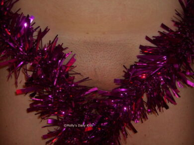 Purple tinsel over pussy