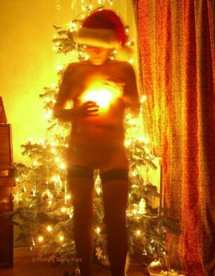 Holding christmas candle