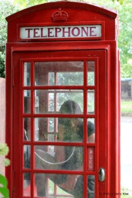 erotic photograph in red telephone box