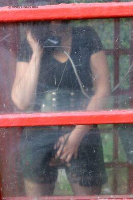 woman masturbating in red phone box