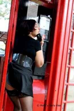 sexy woman in red phone box