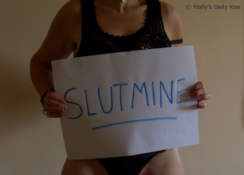 Molly holding sign saying Slutmine
