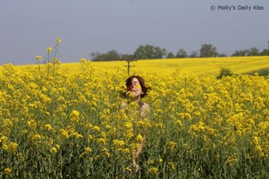 naked woman in a field of rapeseed