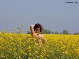 naked in a field of rapeseed