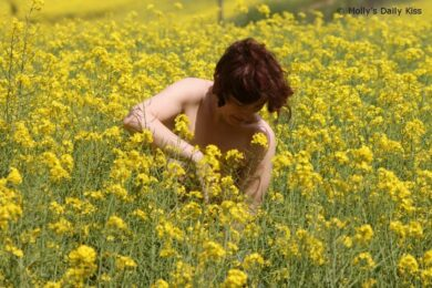 Naked woman in field of corn