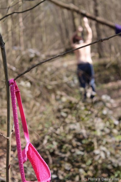 tied up topless in the wood