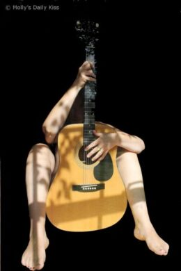 Naked woman with guitar