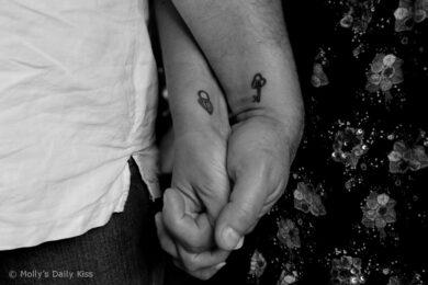 lock and key tattoo on wrists