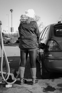 Sexy woman at the petrol pumps