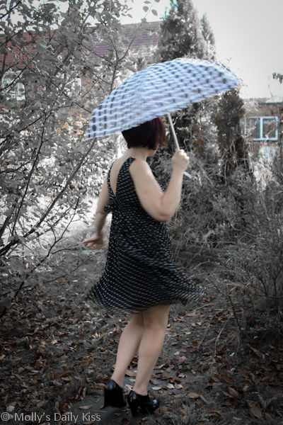 Swirling dress with colour splash and spotty umbrella