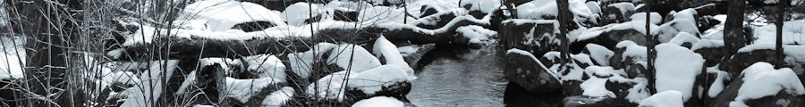 Rocks in the creek at St Peter's Village PA covered in snow