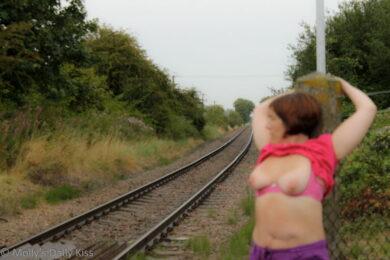 Naked woman on train tracks