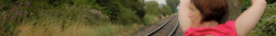Naked woman on train tracks