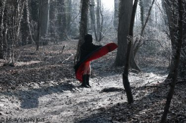 Cloked woman in the woods