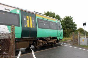 Train on level crossing