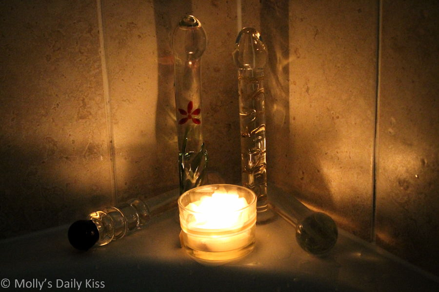 Glass dildos by candle light