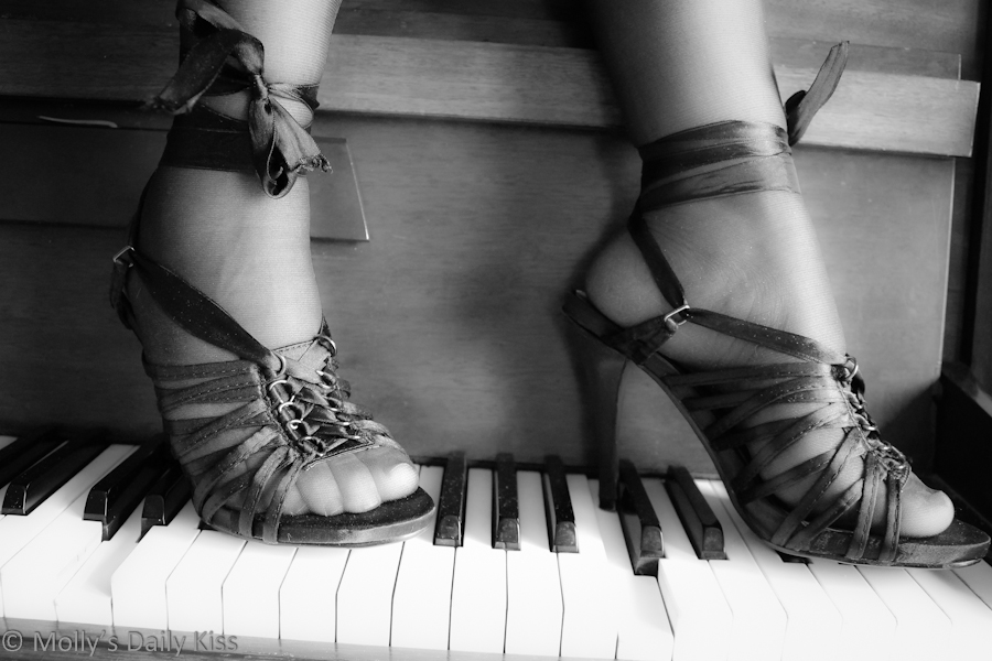 High heeled lace up shoes on piano