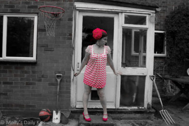 Molly wearing pink dotty dress