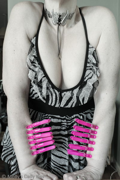 Pink clothes pins on skin BDSM