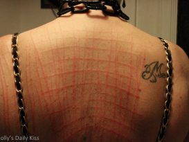 Kink marks making a grid pattern on back BDSM