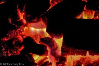 Embers glowing in the fireplace