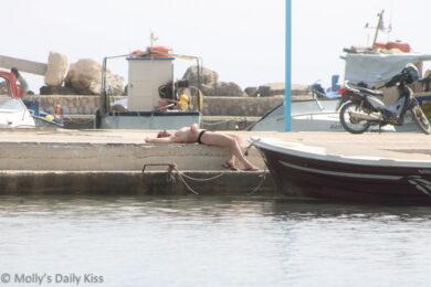 sunbathing naked in Greece