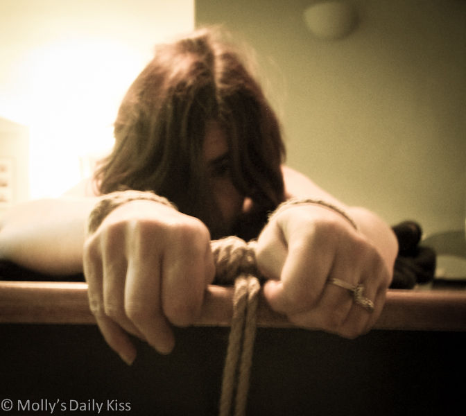 Bound by wrists with rope