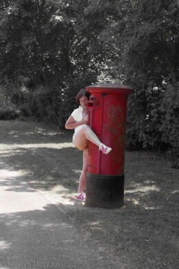 Hugging a red postbox