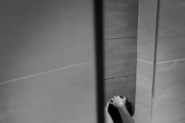 Woman naked sitting in the shower