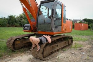 Topless woman on a digger