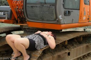 topless woman on construction site