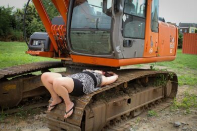 Naked woman on digger