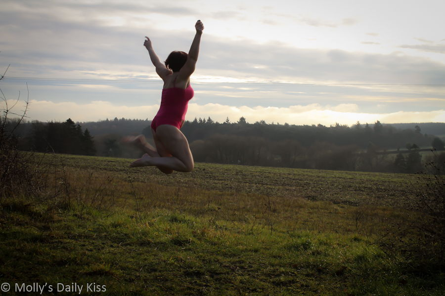 Jumping for joy in pink panties
