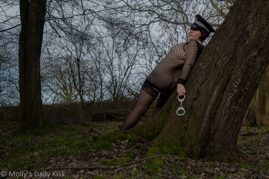 Sexy police woman in the woods