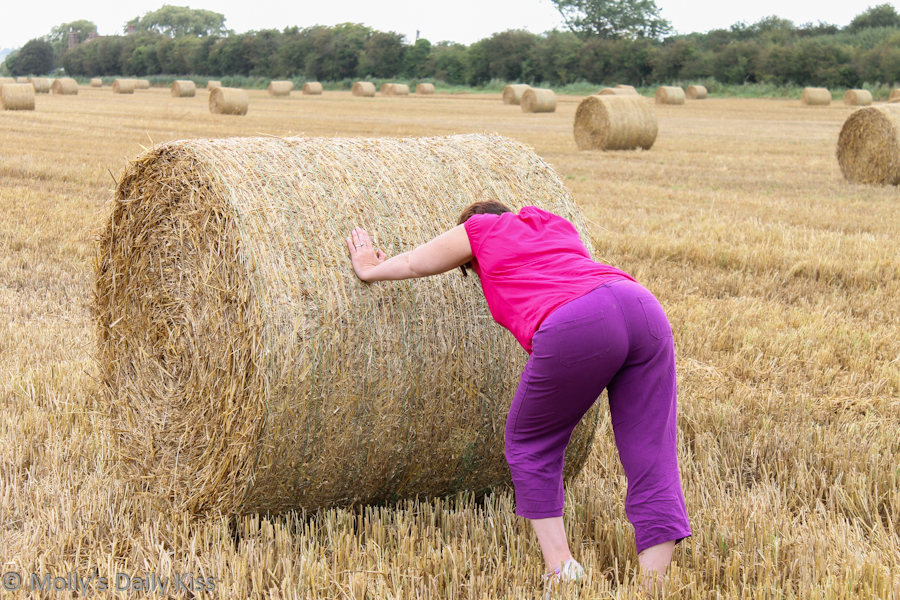 Pushing a circular haybale