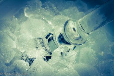 Glass dildo in ice bucket