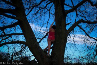 Standing in tree in pink underwear