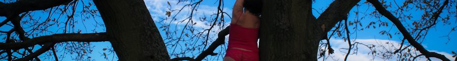 Standing in tree in pink underwear