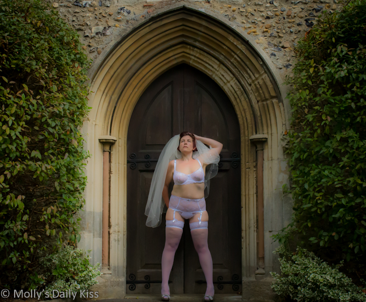 Woman in bridal lingerie outside church Mother's ruin