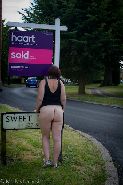 Flashing bum by Estate Agent sign