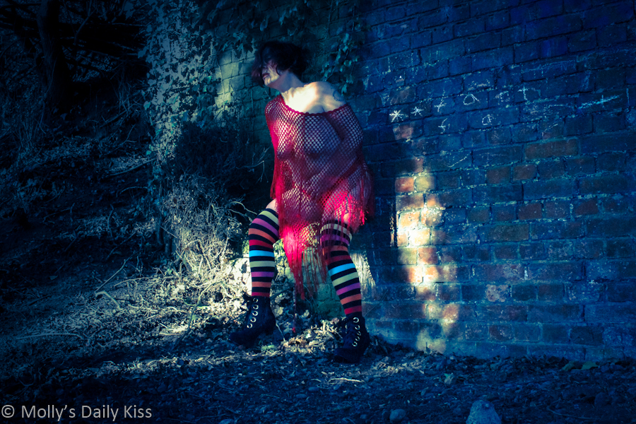 woman topless in stripy socks and high heel boots