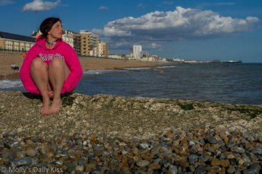 Sitting on Brighton beach in knickers