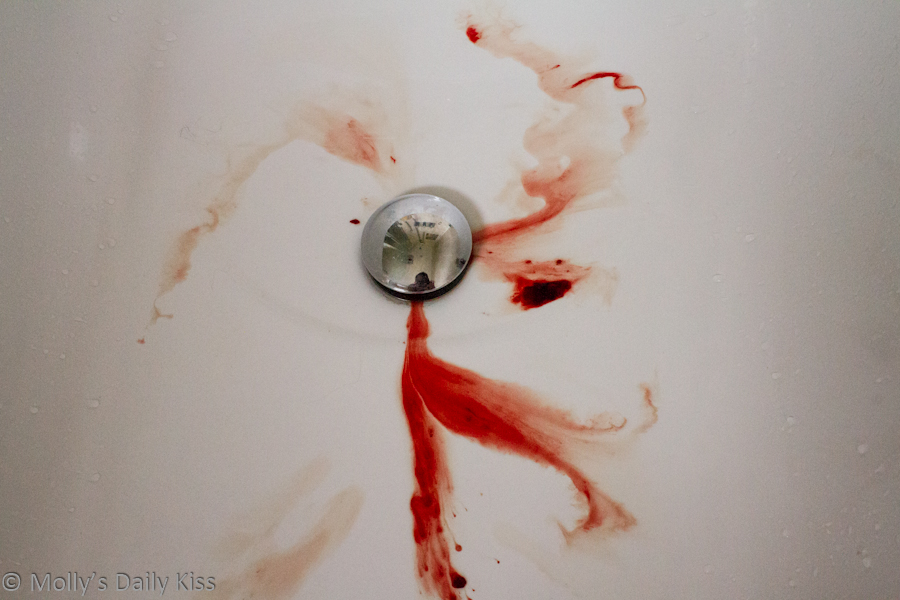 red menstrual blood in the bath