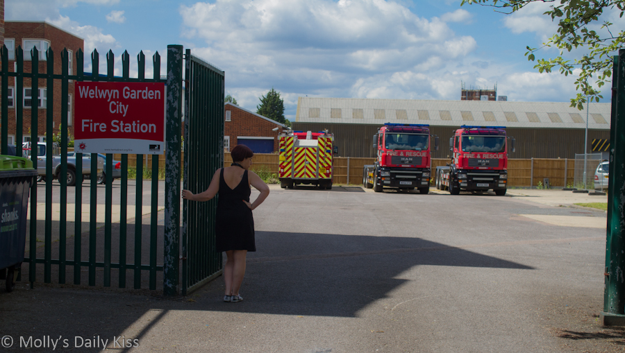 Woman waiting at Fire Station gates
