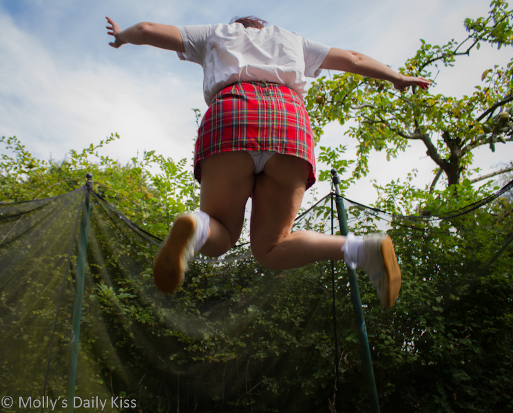 School girl jumping on trampoline