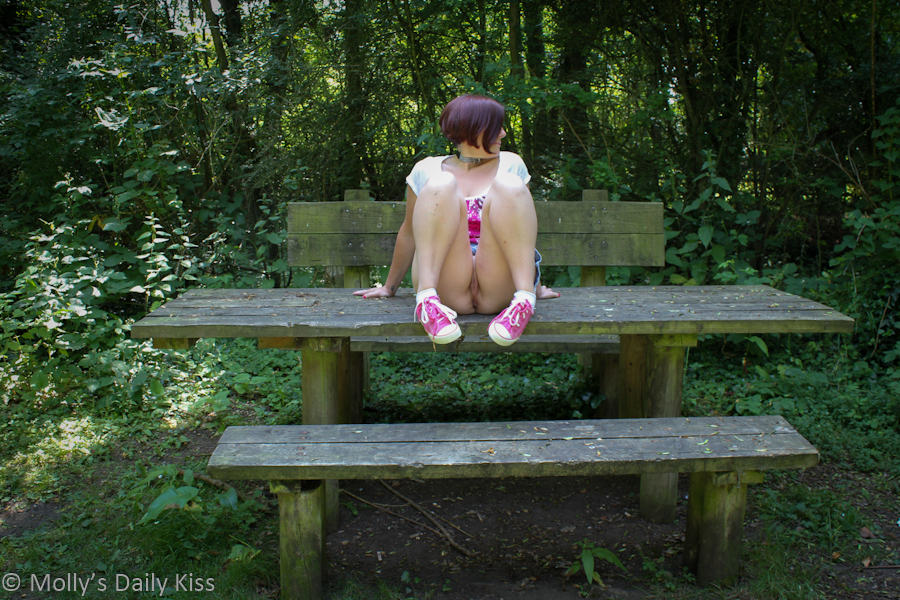 sitting on picnic table showing pussy