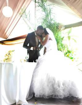 Black bride and groom white wedding