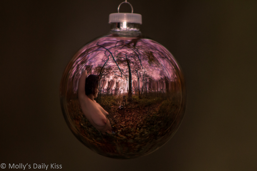 Woman naked inside Christmas bauble
