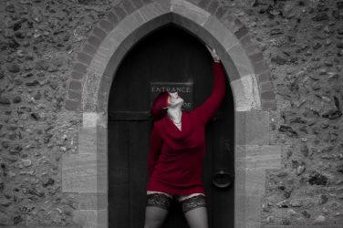 Woman in red in church doorway